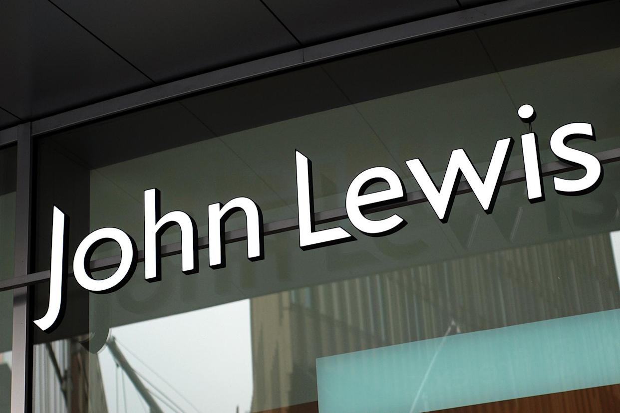 Liverpool, England - February 19, 2011: The sign of John Lewis store in Liverpool. John Lewis is chain of upmarket department stores operating throughout Great Britain.