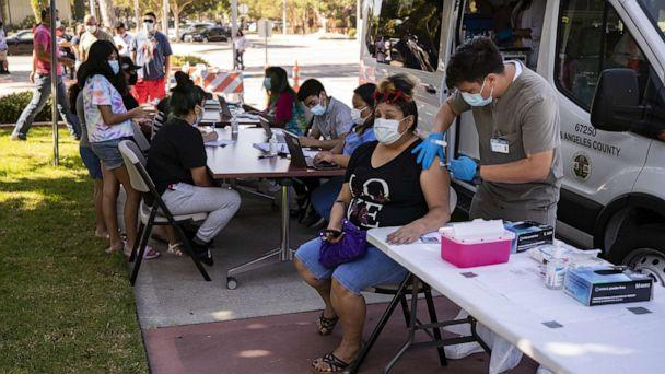 PHOTO: A woman gets vaccinated at a COVID-19 vaccination clinic in Paramount, Calif., Aug. 4, 2021. (Etienne Laurent/EPA via Shutterstock)
