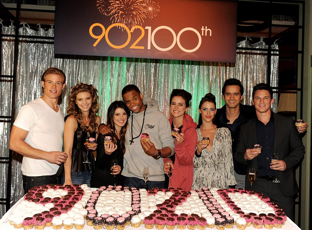"MANHATTAN BEACH, CA - SEPTEMBER 27:  (L-R) Actors Trevor Donovan, AnnaLynne McCord, Shenae Grimes, Tristan Wilds, Jessica Stroup, Jessica Lowndes, Michael Steger and Matt Lanter pose at the 100th episode celebration of The CW's ""90210"" at Manhattan Beach Studios on September 27, 2012 in Manhattan Beach, California.  (Photo by Kevin Winter/Getty Images)"