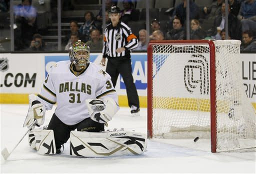 Dallas Stars goalie Richard Bachman reacts after a goal by San Jose Sharks center Michal Handzus, of the Czech Republic, during the first period of an NHL hockey game in San Jose, Calif., Thursday, Feb. 2, 2012. (AP Photo/Tony Avelar)