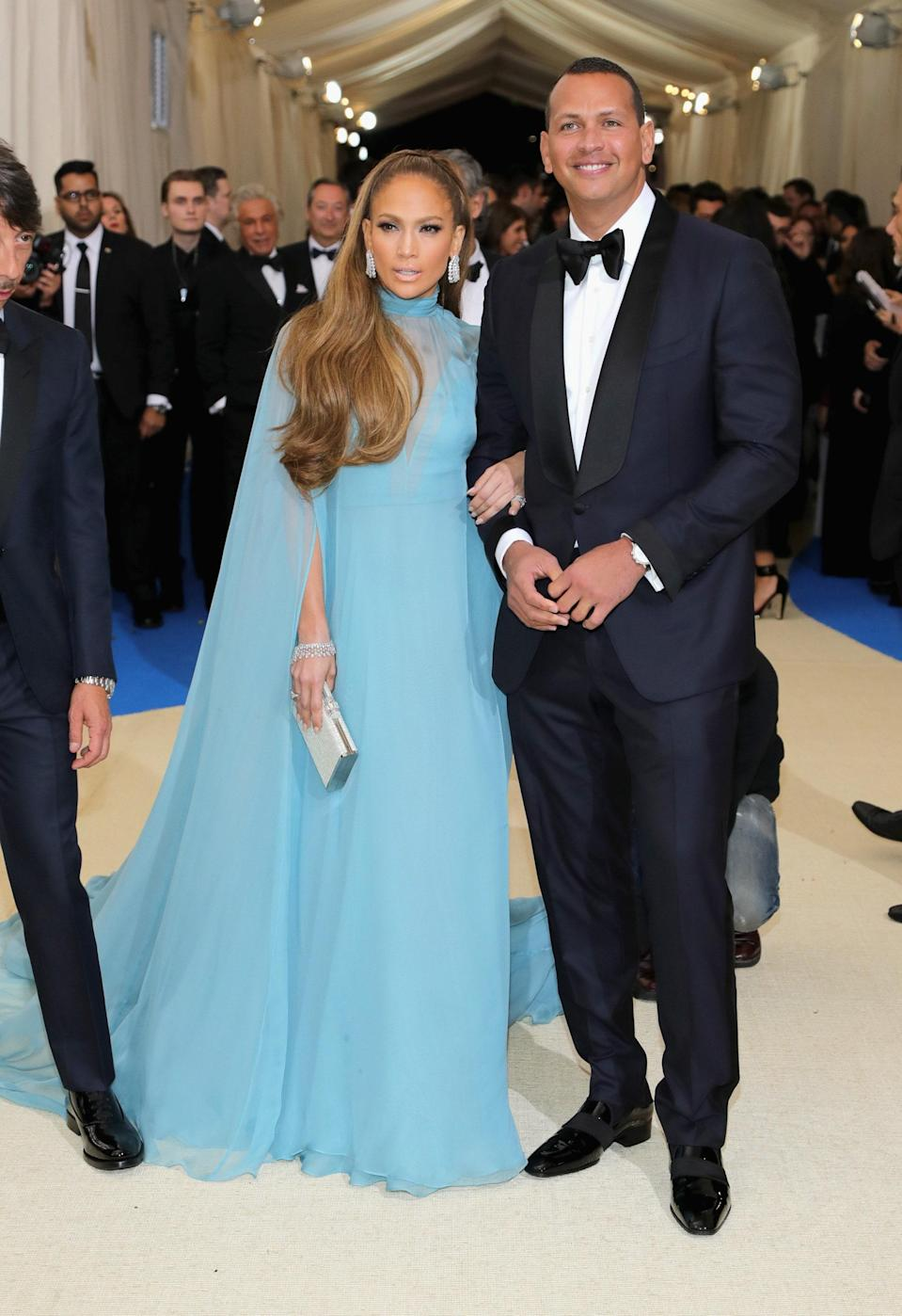 """<h1 class=""""title"""">Jennifer Lopez in Valentino with a Judith Leiber Couture bag and Alex Rodriguez</h1> <cite class=""""credit"""">Photo: Getty Images</cite>"""