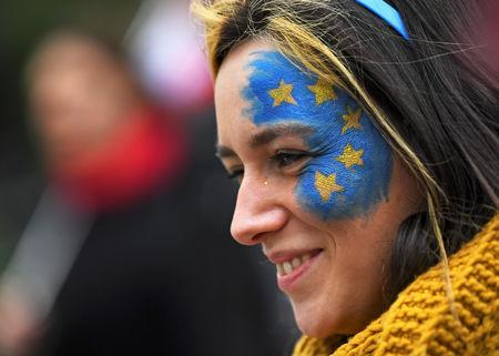 An EU supporter with the EU flag painted on her face, calling on the government to give Britons a vote on the final Brexit deal, participates in the 'People's Vote' march in central London, Britain March 23, 2019. REUTERS/Dylan Martinez