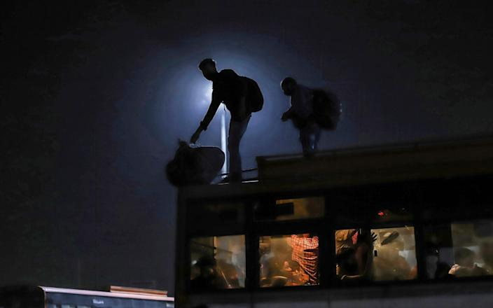 Migrant workers seen at Kaushambi bus stand boarding for their hometowns - SIPA USA/SOPA Images