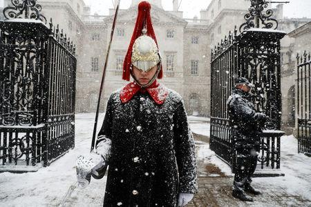 A guardsman stands on duty in the snow at Horse Guards Parade in London, February 28, 2018. REUTERS/Peter Nicholls