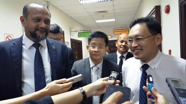 Sarawak DAP chairman Chong Chieng Jen (right) with counsel Gobind Singh Deo and Julian Tan (centre) speaking to reporters after the court has delivered its ruling, September 14, 2017. ― Picture by Sulok Tawie