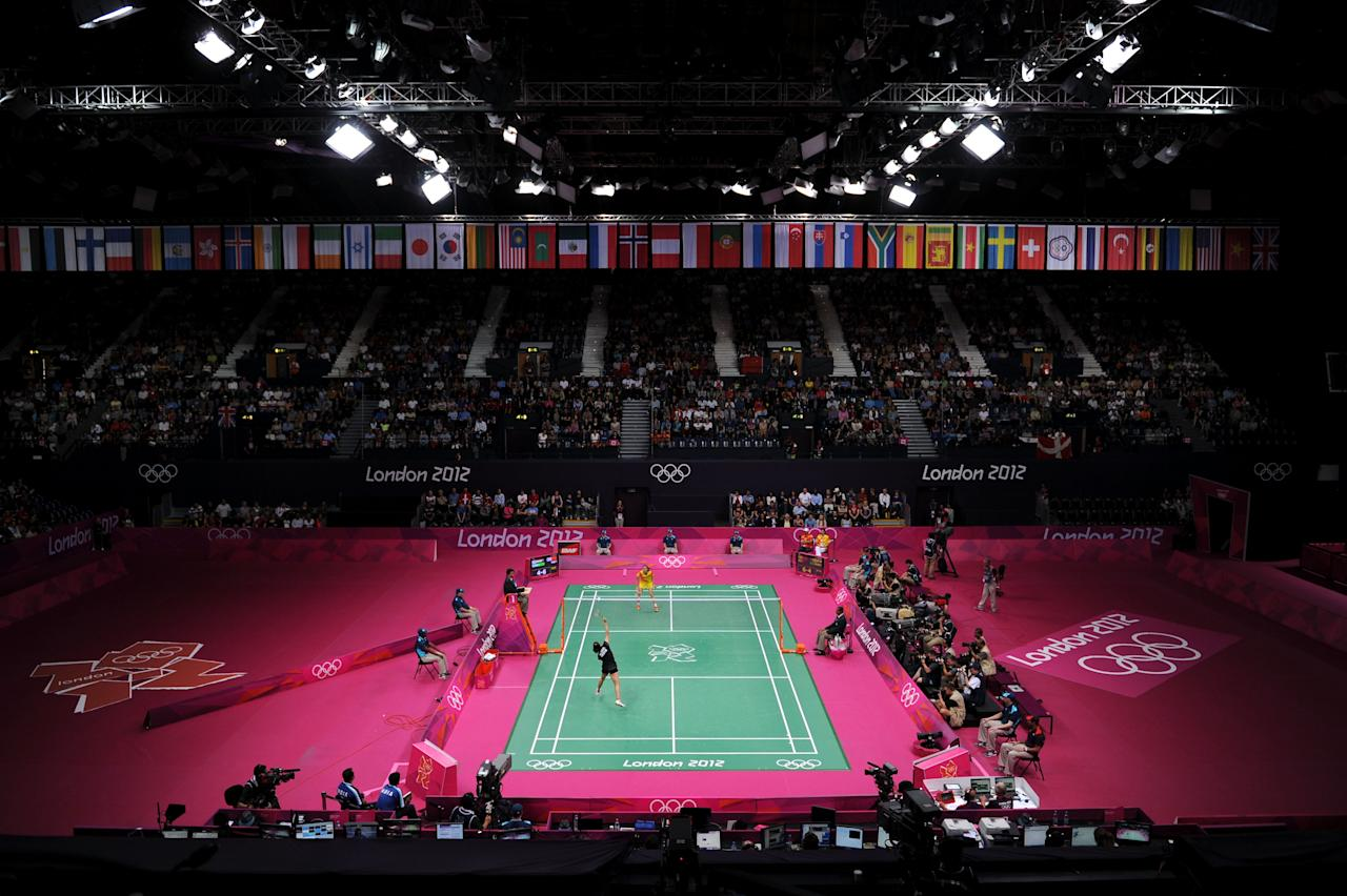 LONDON, ENGLAND - AUGUST 03:  Yihan Wang of China and Saina Nehwal of India compete in the Women's Singles Badminton Semi-Fina on Day 7 of the London 2012 Olympic Games at Wembley Arena on August 3, 2012 in London, England.  (Photo by Michael Regan/Getty Images)