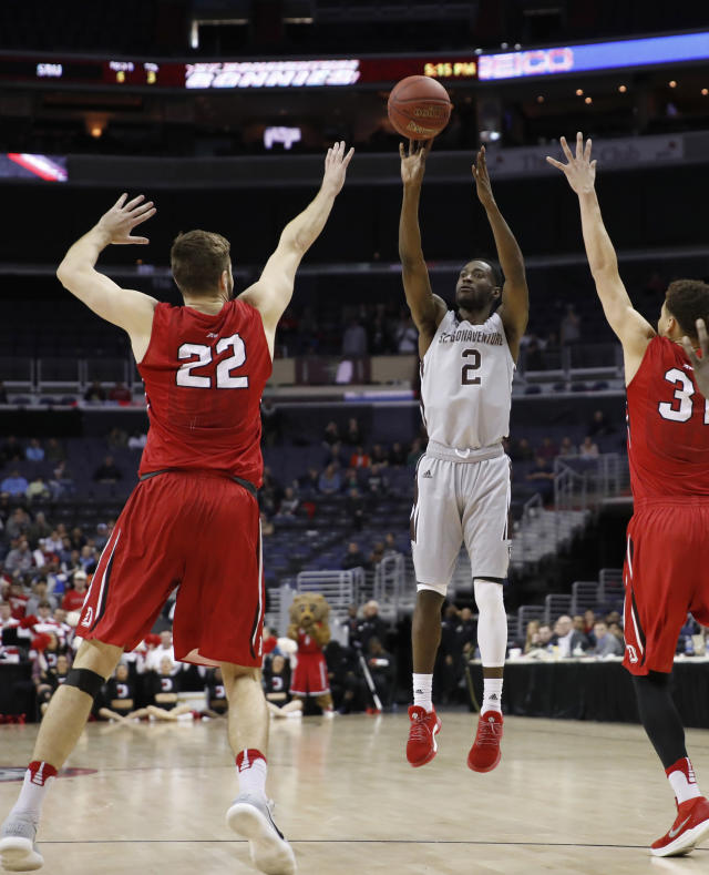 St. Bonaventure guard Matt Mobley (2) shoots between Davidson forward Will Magarity (22) and guard Kellan Grady (31) during the second half of an NCAA college basketball game in the semifinals of the Atlantic 10 Conference tournament, Saturday, March 10, 2018, in Washington. Davidson won 82-70. (AP Photo/Alex Brandon)