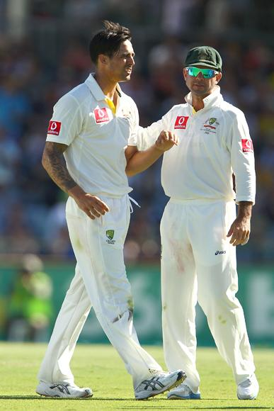 Mitchell Johnson of Australia is congratulated by Ricky Ponting after dismissing Faf du Plessis of South Africa during day three of the Third Test Match between Australia and South Africa at WACA on December 2, 2012 in Perth, Australia.  (Photo by Paul Kane/Getty Images)
