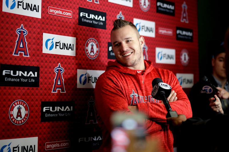Mike Trout will reportedly stay an Angel for the foreseeable future. (AP Photo/Chris Carlson)