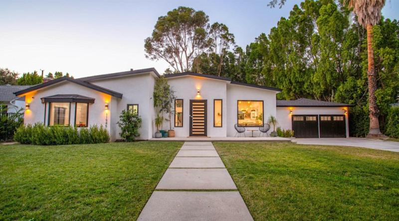 The quarter-acre property includes a remodeled single-story home, a studio and a swimming pool with a wraparound deck.