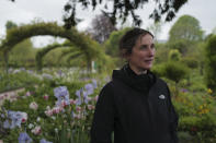 English gardener Claire-Helene Marron looks on in the garden of Claude Monet's house, French impressionist painter who lived from 1883 to 1926, ahead of the re-opening, in Giverny, west of Paris, Monday May 17, 2021. Lucky visitors who'll be allowed back into Claude Monet's house and gardens for the first time in over six months from Wednesday will be treated to a riot of color, with tulips, peonies, forget-me-nots and an array of other flowers all competing for attention. (AP Photo/Francois Mori)