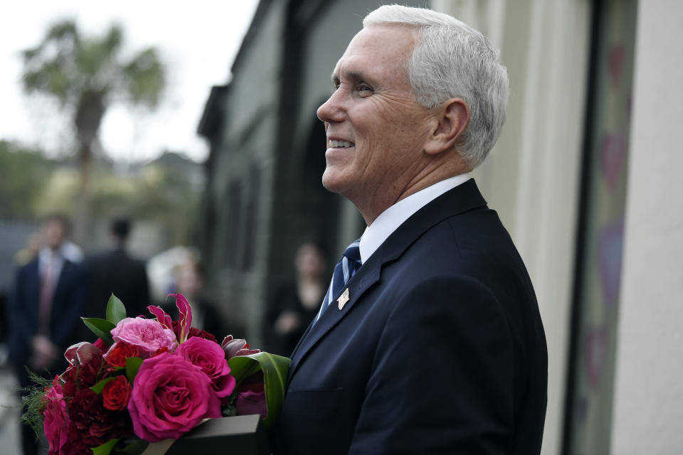 Vice President Mike Pence stops outside a flower shop after purchasing a Valentine's Day bouquet during a trip Thursday, Feb. 13, 2020, to Charleston, S.C. (AP Photo/Meg Kinnard