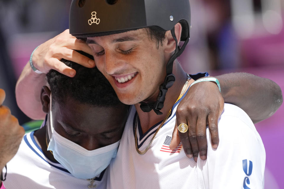 Cory Juneau of the United States is greeted by Zion Wright of the United States during the men's park skateboarding finals at the 2020 Summer Olympics, Thursday, Aug. 5, 2021, in Tokyo, Japan. (AP Photo/Ben Curtis)
