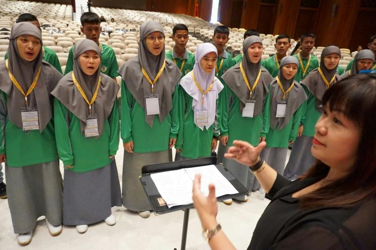 Muslim students from the Attarkia Islamiah Institute sing during a rehearsal of their papal performance