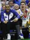 Kentucky's PJ Washington, left, wearing a cast on his left foot, and Reid Travis (22) cheer for their team during the second half against Abilene Christian in a first-round game in the NCAA mens college basketball tournament Thursday, March 21, 2019, in Jacksonville, Fla. (AP Photo/Stephen B. Morton)