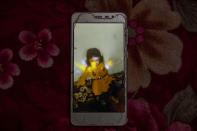 A mobile photograph of two-year-old Liyan Taher, who was killed with her father 32-year-old Taher Farag on June 5, 2021 in a ballistic missile and an explosive-laden drone fired by Yemen's Houthi rebels that hit a fuel station in Rawdha neighborhood, at their home in Marib, Yemen, Saturday, June 19, 2021. (AP Photo/Nariman El-Mofty)