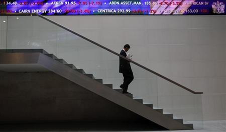 A man walks down steps under a share price ticker at the London Stock Exchange in the City of London November 1, 2011. REUTERS/Andrew Winning