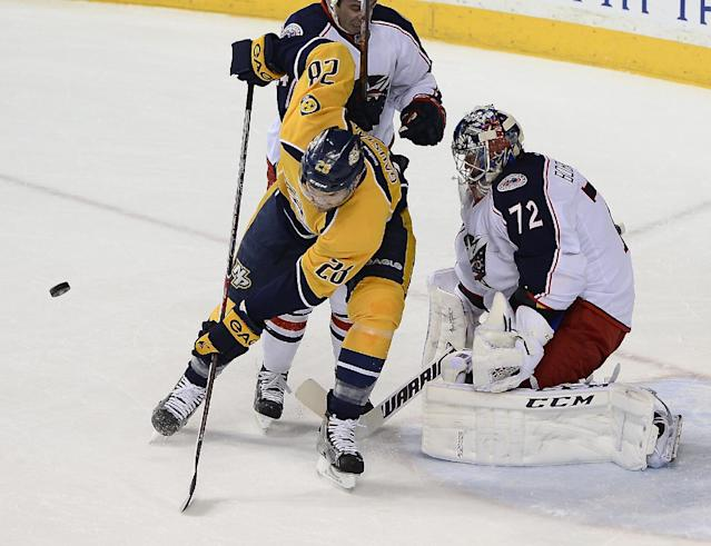 Nashville Predators forward Paul Gaustad (28) deflects a shot in front of Columbus Blue Jackets goalie Sergei Bobrovsky (72), of Russia, in the first period of an NHL hockey game on Saturday, March 8, 2014, in Nashville, Tenn. (AP Photo/Mark Zaleski)