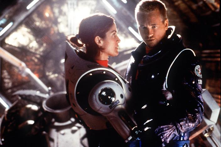 """381454 02: Carrie-Anne Moss (as Commander Kate Bowman) and Val Kilmer (as astronaut Robby Gallagher) travel to Mars to investigate human living conditions on that planet in Warner Bros. Pictures'' and Village Roadshow Pictures'' epic romantic adventure, """"Red Planet."""" (Photo by Jasin Boland/Warner Bros./Newsmakers)"""