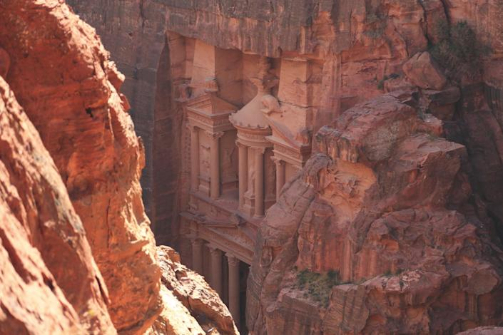 "A narrow mile-long passageway opens onto the dramatic pink-hued mausoleum known as the Treasury, or Al-Khazneh, at the ancient city of Petra, which was once an important center of trade in the region. ""Petra is now full of tourists—itself a cause of possible concern, in case they ruin the fragile site,"" Joffe says. ""Yet in a poetic sense, those multitudes reflect bustling Petra in its third-century heyday, after centuries when it stayed hidden to all but the odd Bedouin shepherd."""