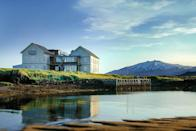 """It may seem strange to include a hotel in a list of so many natural wonders, but that's a testament to just how beautiful <a href=""""https://www.cntraveler.com/hotels/iceland/budir/hotel-budir?mbid=synd_yahoo_rss"""" rel=""""nofollow noopener"""" target=""""_blank"""" data-ylk=""""slk:Hótel Buđir"""" class=""""link rapid-noclick-resp"""">Hótel Buđir</a> really is. Its magical setting on a remote peninsula two hours from Reykjavik features the sea behind it, lava fields in front of it, and a tiny black church beside it. The hotel itself is rustic-chic, and even offers wake-up calls if and when the Northern Lights make a late-night appearance."""