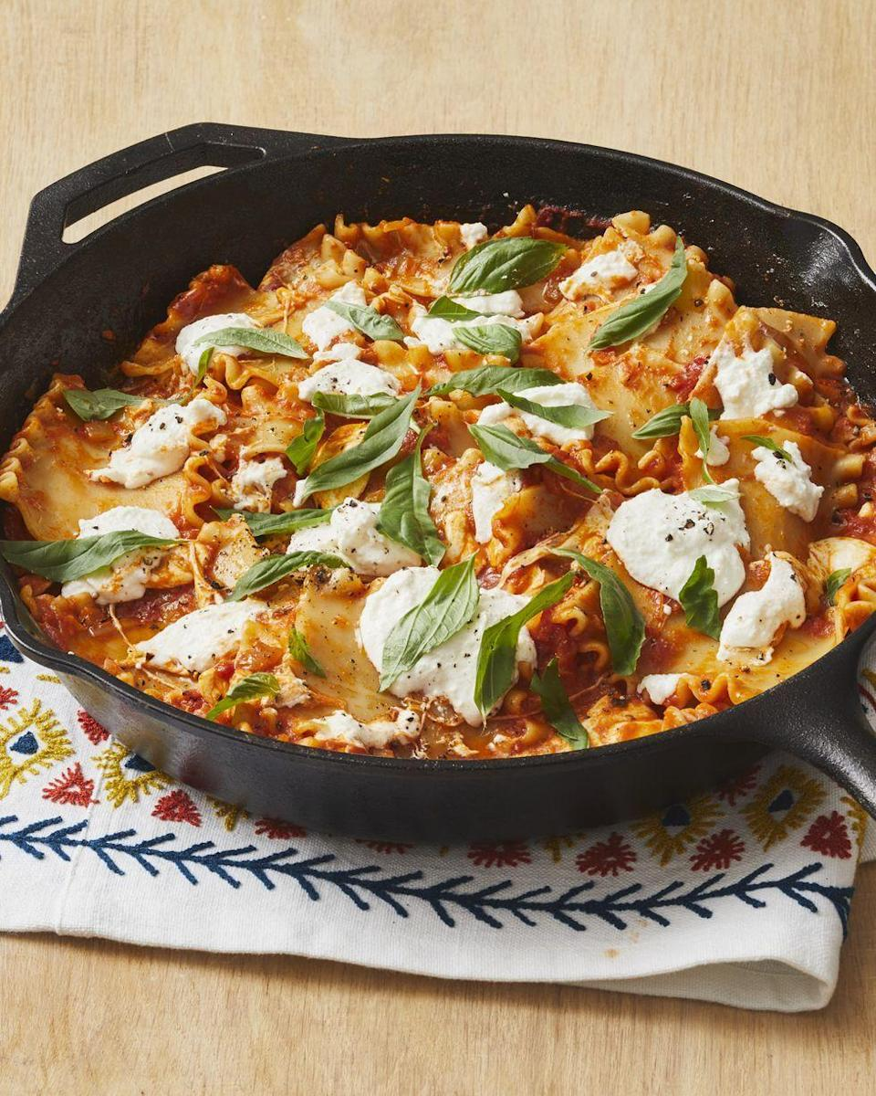"""<p>Cook a hearty lasagna right in your skillet with this easy 35-minute recipe. Serve with buttery garlic bread!</p><p><strong><a href=""""https://www.thepioneerwoman.com/food-cooking/recipes/a32438760/skillet-lasagna-recipe/"""" rel=""""nofollow noopener"""" target=""""_blank"""" data-ylk=""""slk:Get the recipe."""" class=""""link rapid-noclick-resp"""">Get the recipe.</a></strong> </p>"""