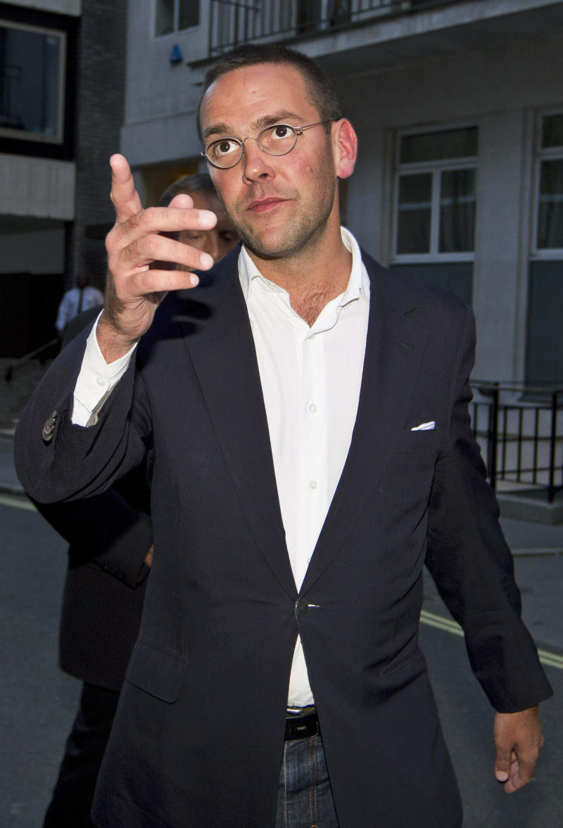 FILE - This is a  Sunday July 10, 2011 photo of then Chief executive of News Corporation Europe and Asia, James Murdoch gesturing as he leaves his father Chairman of News Corporation Rupert Murdoch's residence, in central London. Britain's Sky News says media executive James Murdoch, under pressure over his role in Britain's tabloid phone hacking scandal, is stepping down as chairman of British Sky Broadcasting. Sky, the news channel of BSkyB, reports that the resignation will be confirmed later Tuesday April 3, 2012 after a board meeting. (AP Photo/Sang Tan, File)