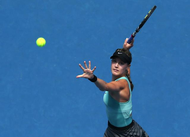 Eugenie Bouchard of Canada looks at the ball for a return to Ana Ivanovic of Serbia during their quarterfinal at the Australian Open tennis championship in Melbourne, Australia, Tuesday, Jan. 21, 2014.(AP Photo/Eugene Hoshiko)