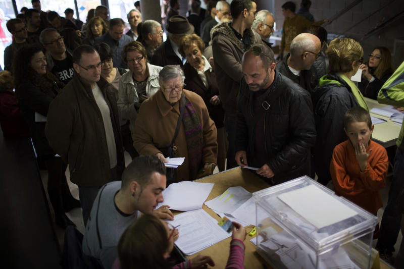 Voters wait to cast their ballots in a polling station in Barcelona, Spain, on Sunday, Nov. 25, 2012. Voters in Catalonia begin casting their ballots in regional elections that could determine the future shape of Spain. If voters give the regional government strong support, its leader pledged to hold a referendum asking Catalans if they'd prefer to split from Spain and go it alone in the 27-member EU. (AP Photo/Emilio Morenatti)