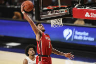 Utah's Timmy Allen drives to the basket past Oregon State's Ethan Thompson during the second half of an NCAA college basketball game in Corvallis, Ore., Thursday, Feb. 18, 2021. (AP Photo/Amanda Loman)