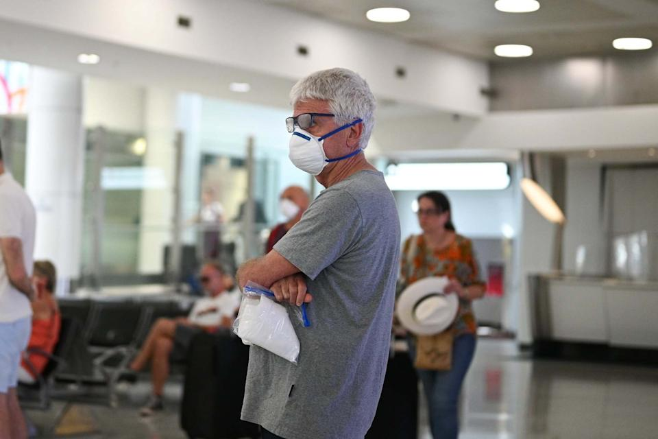 A man wearing a protective face mask in Kingsford Smith International Airport (REUTERS)