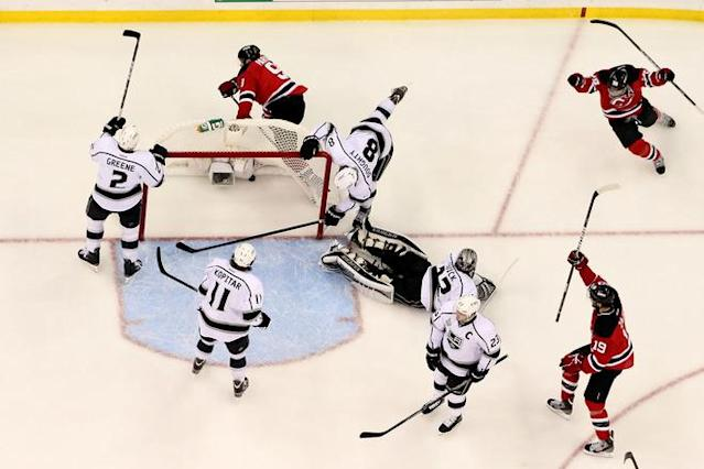 NEWARK, NJ - JUNE 09: Zach Parise #9 of the New Jersey Devils celebrates with Patrik Elias #26 and Travis Zajac #19 after Parise scores a goal against Jonathan Quick #32 of the Los Angeles Kings in the first period as Matt Greene #2, Anze Kopitar #11, Drew Doughty #8 and Dustin Brown #23 look on during Game Five of the 2012 NHL Stanley Cup Final at the Prudential Center on June 9, 2012 in Newark, New Jersey. (Photo by Bruce Bennett/Getty Images)