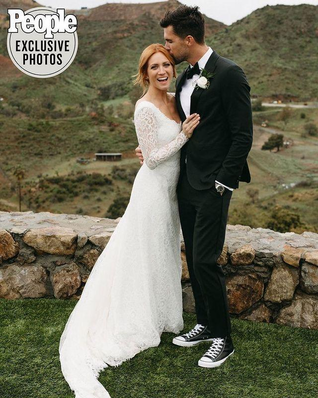 """<p>Pitch Perfect star Brittany Snow revealed her classic, but low-key, wedding dress with People Magazine.</p><p>The 33 year-old wore a stunning lace Jonathan Simkhai gown which featured a scoop neck, sheer arms and a train to marry Tyler Stanaland in Malibu.</p><p><a href=""""https://www.instagram.com/p/B9wtU_nJKgP/"""" rel=""""nofollow noopener"""" target=""""_blank"""" data-ylk=""""slk:See the original post on Instagram"""" class=""""link rapid-noclick-resp"""">See the original post on Instagram</a></p>"""