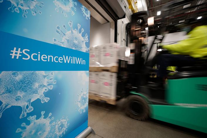 Boxes containing the Pfizer-BioNTech COVID-19 vaccine are loaded Sunday onto a truck for shipping at the Pfizer Global Supply manufacturing plant in Portage, Mich.