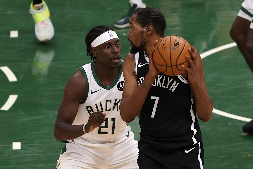 Jrue Holiday and the Bucks will try to take advantage of a depleted Nets team, led by Kevin Durant. (Photo by Stacy Revere/Getty Images)