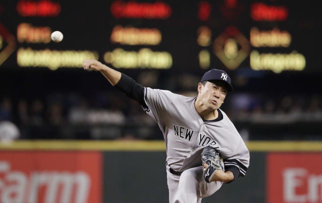 New York Yankees starting pitcher Masahiro Tanaka throws to a Seattle Mariners batter during the fourth inning of a baseball game Tuesday, Aug. 27, 2019, in Seattle. (AP Photo/Elaine Thompson)