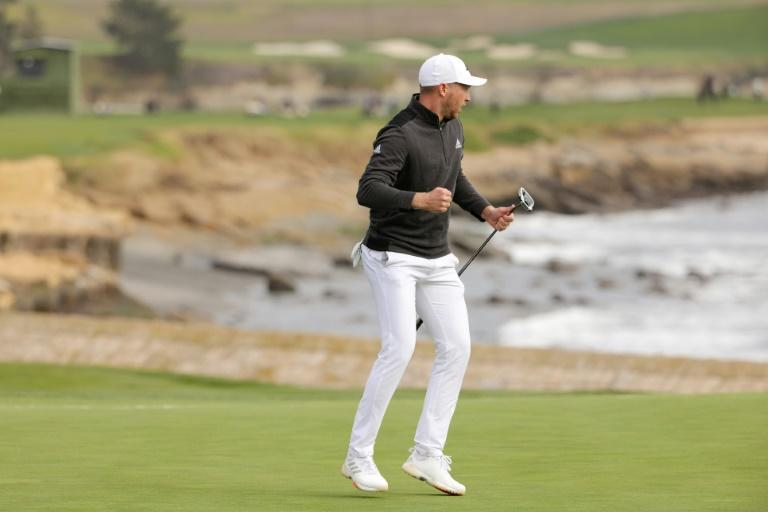 American Daniel Berger celebrates his eagle putt at 18 for victory in the US PGA Tour Pebble Beach Pro-Am