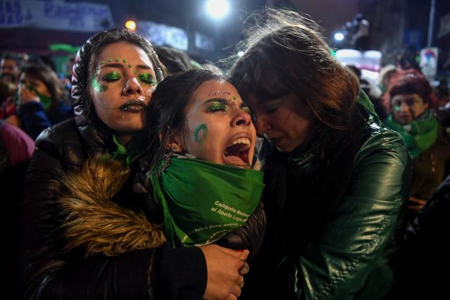 <p>Activists in favour of the legalization of abortion comfort each other outside the National Congress in Buenos Aires, on Aug. 9, 2018 after senators rejected the bill to legalize the abortion. (Photo: Eitan Abramovich/AFP/Getty Images) </p>
