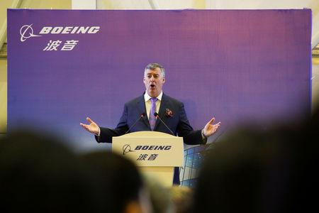 FILE PHOTO: Boeing Commercial Airplanes CEO Kevin McAllister speaks during a ceremony marking the 1st delivery of a Boeing 737 Max passenger airplane to Air China at the Boeing Zhoushan completion center in Zhoushan, Zhejiang province, China, December 15, 2018.  REUTERS/Thomas Peter