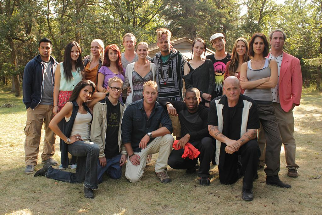 SIBERIA -- Pictured: (l-r) Back Row,  Harpreet, Irene, Berglind, Victoria, Johnny, Natalie, Tommy, Annie, Miljan, Esther, Sabina, George, (l-r) Front Row, Carolina, Daniel, Host Jonathan Buckley, Neeko, Sam - (Photo by: Jamie Winterstern/NBC)