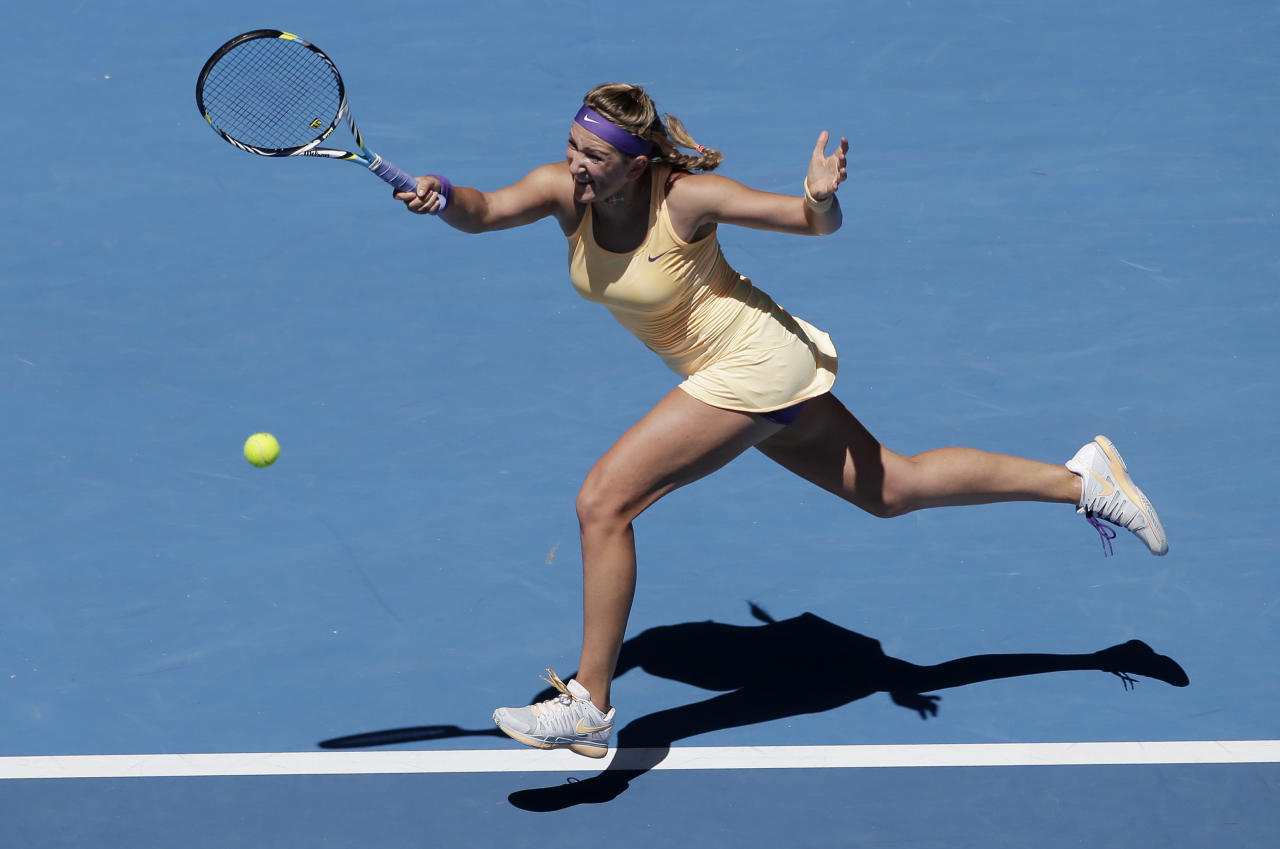 Victoria Azarenka of Belarus hits a forehand return to Russia's Svetlana Kuznetsova during their quarterfinal match at the Australian Open tennis championship in Melbourne, Australia, Wednesday, Jan. 23, 2013. (AP Photo/Rob Griffith)