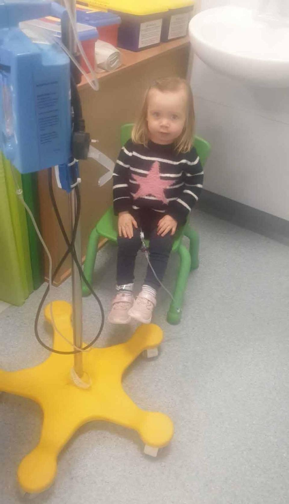 Evie playing during chemotherapy. PA REAL LIFE COLLECT