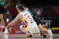 China's Siyu Wang (5) and Australia's Katie Ebzery battle for the ball during a women's basketball preliminary round game at the 2020 Summer Olympics in Saitama, Japan, Friday, July 30, 2021. (AP Photo/Eric Gay)