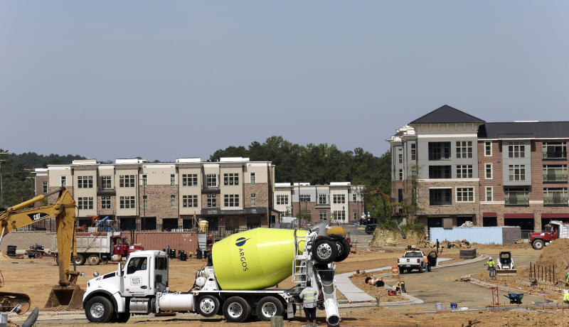 This photo taken Monday, July 1, 2019 shows new construction underway at Carraway Village, a mixed-use community in Chapel Hill, N.C. (AP Photo/Gerry Broome)