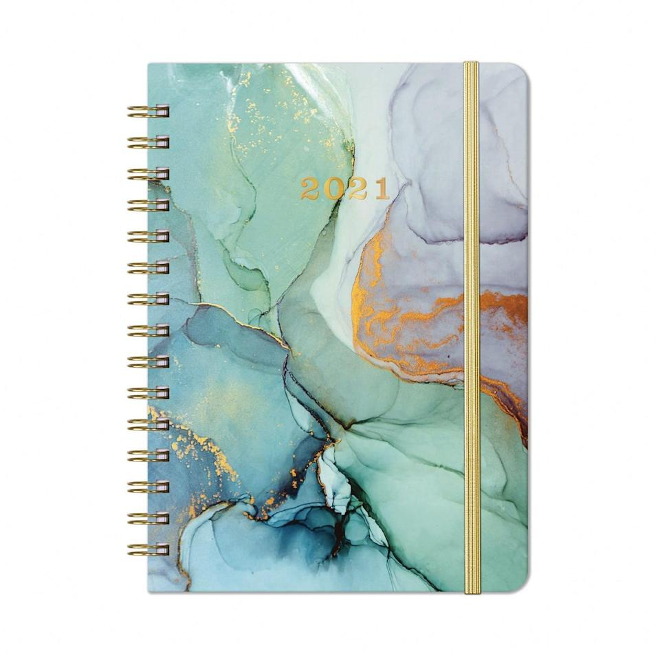 "The rave reviews on this affordable planner prove its pretty design isn't the only thing to love about it. Inside you'll find monthly and weekly planning pages and a list of holidays and maps, all wrapped up in one great-looking design. $14, Amazon. <a href=""https://www.amazon.com/2020-Planner-Prelabeled-Twin-Wire-Hardcover/dp/B07W6YKX75/"" rel=""nofollow noopener"" target=""_blank"" data-ylk=""slk:Get it now!"" class=""link rapid-noclick-resp"">Get it now!</a>"