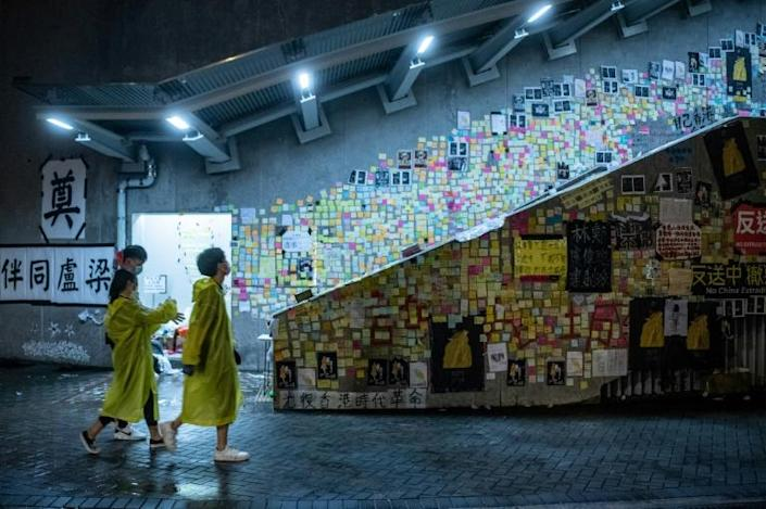 Plastered in colourful sticky-notes, posters and slogans, 'Lennon Walls' have sprung up in more than a hundred locations across the city (AFP Photo/Philip FONG)