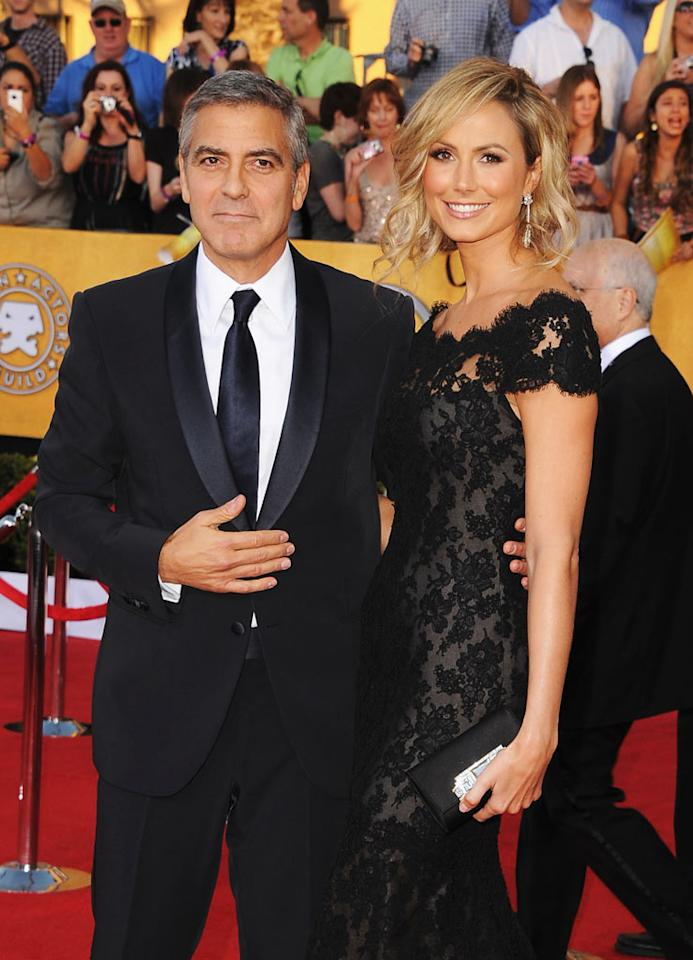 "George Clooney looks like he's going to be a dad, reports <i>""The Insider.""</i> According to the celebrity TV show, new photos taken in Italy of Clooney's girlfriend Stacy Keibler show her with a ""tiny baby bump,"" indicating she's pregnant. For how far along she is, and how longtime bachelor Clooney is reacting to the news, go to <a target=""_blank"" href=""http://www.gossipcop.com/stacy-keibler-pregnant-baby-bump-george-clooney-june-2012-picture-photo/"">Gossip Cop</a>."