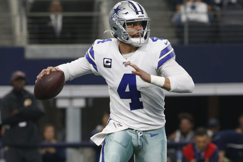 FILE - In this Dec. 15, 2019, file photo, Dallas Cowboys quarterback Dak Prescott looks to throw against the Washington Redskins during the first half of an NFL football game in Arlington, Texas. The Cowboys continue to play the waiting game with their free agents. With the current collective bargaining agreement still in place and uncertainty whether a new one will be in force before the new league season begins next month, negotiations between Cowboys executive vice president Stephen Jones and Prescott have gone nowhere. (AP Photo/Ron Jenkins, File)