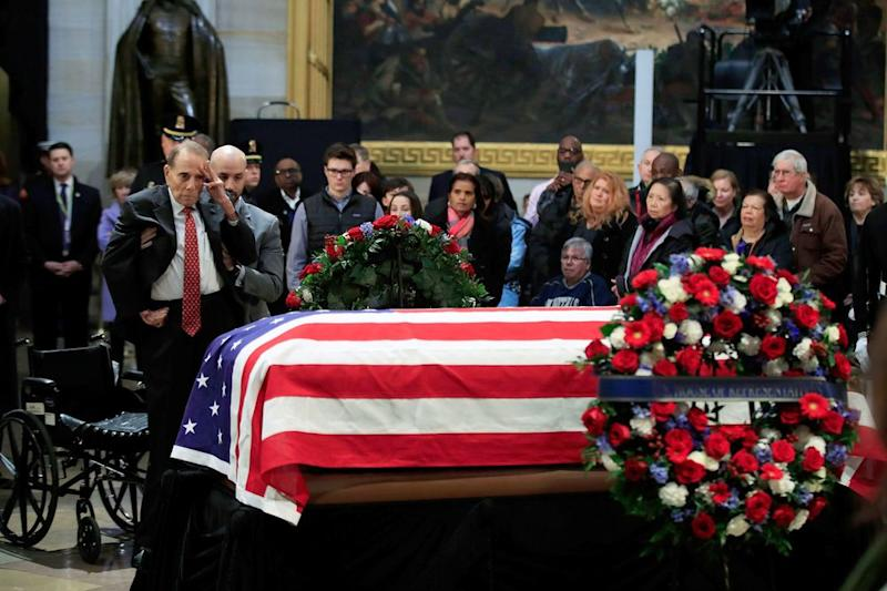 Former Sen Bob Dole 95 Helped Out Of Wheelchair To Salute Casket Of Former Opponent George H W Bush