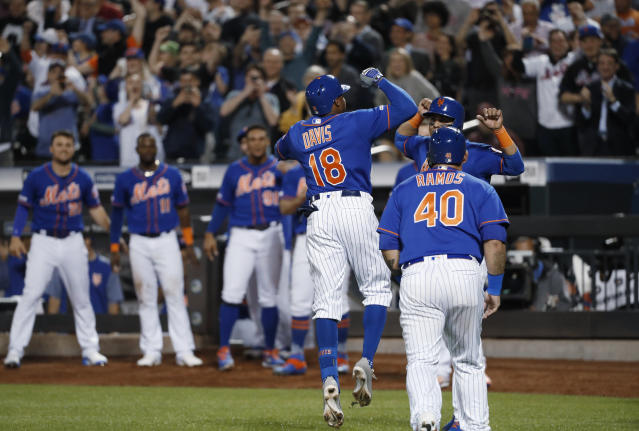 New York Mets' Rajai Davis (18) celebrates with teammates after hitting a three-run home run during the eighth inning of the team's baseball game against the Washington Nationals, Wednesday, May 22, 2019, in New York. (AP Photo/Kathy Willens)